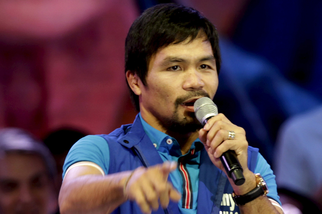 Filipino boxer Manny Pacquiao, who is running for Senator in the May 2016 vice-presidential election, speaks to supporters during the start of national elections campaigning in Mandaluyong city, M ...