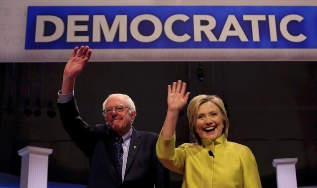 Bernie Sanders and Hillary Clinton arrive on stage ahead of the start of the PBS NewsHour Democratic presidential candidates debate in Milwaukee, Wisconsin, February 11, 2016. (Darren Hauck/Reuters)