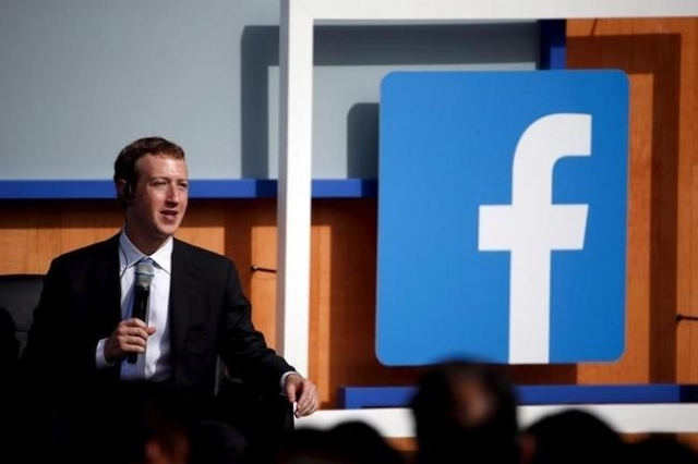 Facebook CEO Mark Zuckerberg speaks on stage during a town hall with Indian Prime Minister Narendra Modi at Facebook's headquarters in Menlo Park, California September 27, 2015. (Reuters/Ste ...