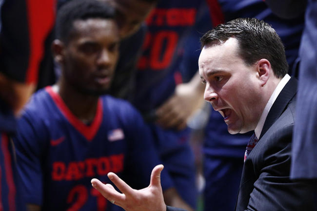 Feb 12, 2016; Kingston, RI, USA; Dayton Flyers head coach Archie Miller (R) speaks to his team during the second half of a game against the Rhode Island Rams at Thomas M. Ryan Center. Mandatory Cr ...