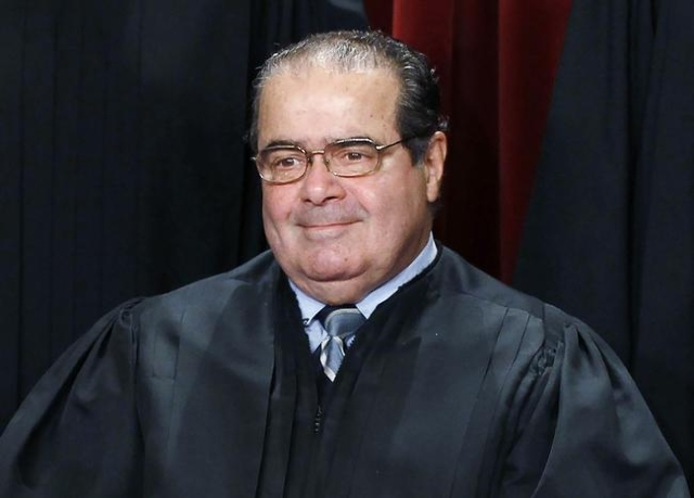 U.S. Supreme Court Justice Antonin Scalia is seen during a group portrait in the Supreme Court Building in Washington, Oct. 8, 2010. Scalia, 79, was found dead on Saturday in Texas. (Larry Downing ...