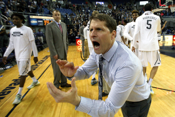Feb 13, 2016; Reno, NV, USA; Nevada Wolf Pack head coach Eric Musselman celebrates with his team after they defeated the Fresno State Bulldogs at Lawlor Events Center. Mandatory Credit: Lance Iver ...