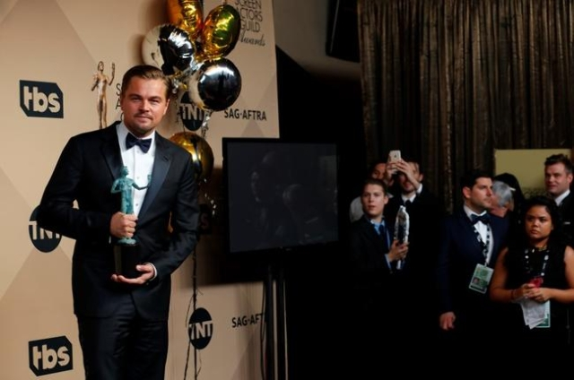 "Actor Leonardo DiCaprio poses backstage with his award for Outstanding Performance by a Male Actor in a Leading Role for his role in ""The Revenant"" at the 22nd Screen Actors Guild Awards ..."