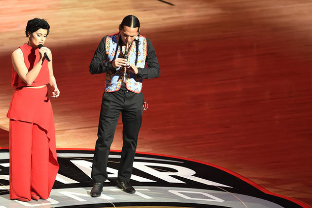Feb 14, 2016; Toronto, Ontario, CAN; Nelly Furtado (L) performs the Canadian anthem prior to the NBA All Star Game at Air Canada Centre. (Peter Llewellyn/USA Today Sports)