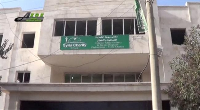 A sign is seen on the building of what is said to be a hospital damaged by missile attacks in Azaz, Aleppo, Syria, February 15, 2016 in this still image taken from a video on a social media websit ...