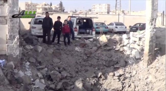 People gather near what is said to be a hospital damaged by missile attacks in Azaz, Aleppo, Syria, February 15, 2016 in this still image taken from a video on a social media website. (Social Medi ...