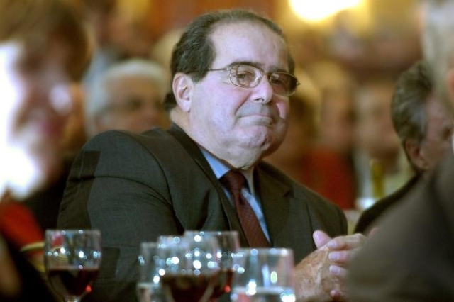 U.S. Supreme Court Justice Antonin Scalia sits in the audience at a National Italian American Foundation event in Washington, in this file photo taken October 20, 2006. (Reuters/Jonathan Ernst/Files)