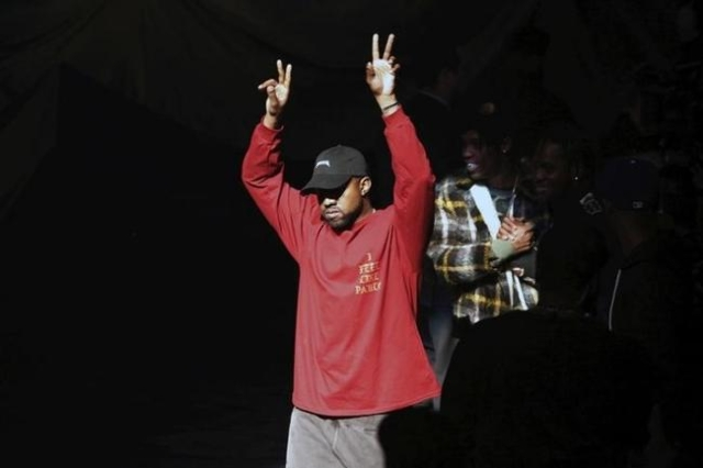 "Kanye West acknowledges attendees before his Yeezy Season 3 Collection presentation and listening party for the ""The Life of Pablo"" album during New York Fashion Week February 11, 2016.  ..."