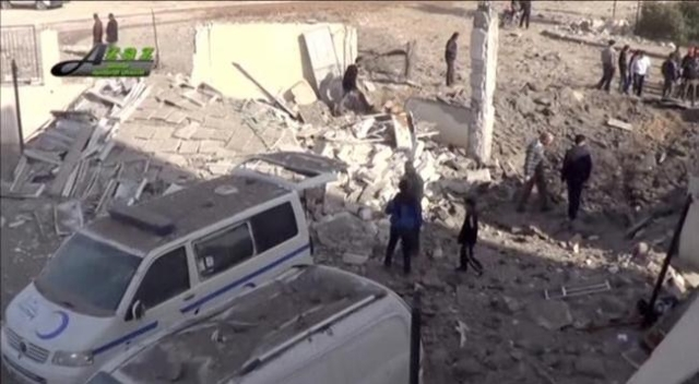 People gather near what is said to be a hospital damaged by missile attacks in Azaz, Aleppo, Syria, February 15, 2016 in this still image taken from a video on a social media website. (Reuters)