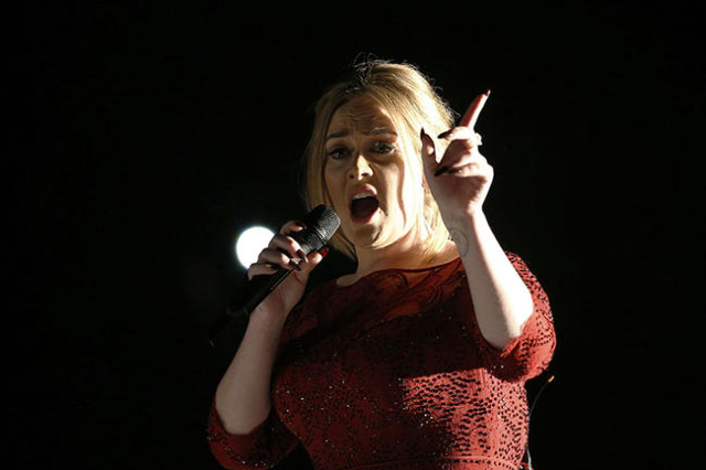 """Singer Adele performs """"All I Ask"""" on stage at the 58th Grammy Awards in Los Angeles, California February 15, 2016.  REUTERS/Mario Anzuoni"""