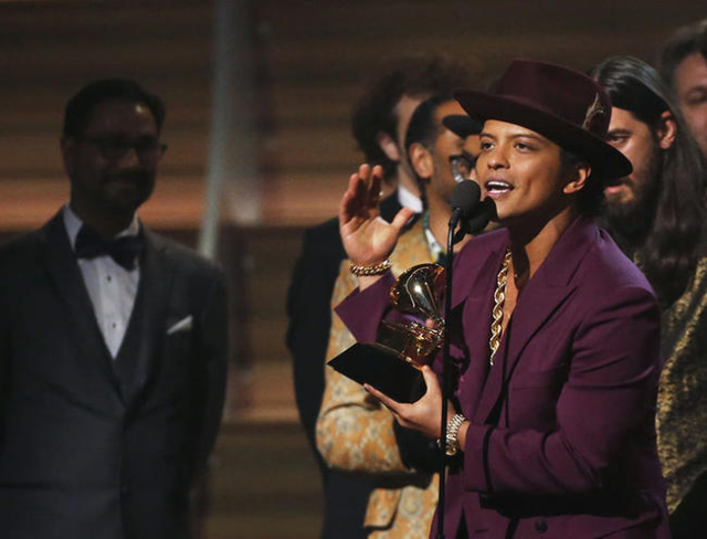 Singer Bruno Mars accepts the Best Record of the Year award. REUTERS/Mario Anzuoni