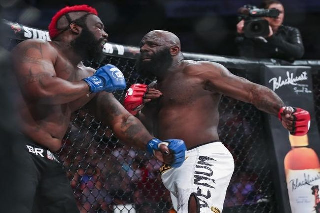 Feb 19, 2016; Houston, TX, USA; Kimbo Slice (red gloves) competes against Dada 5000 (blue gloves) during their Heavyweight fight at Bellator 149 at Toyota Center. (Reuters/Troy Taormina-USA TODAY  ...