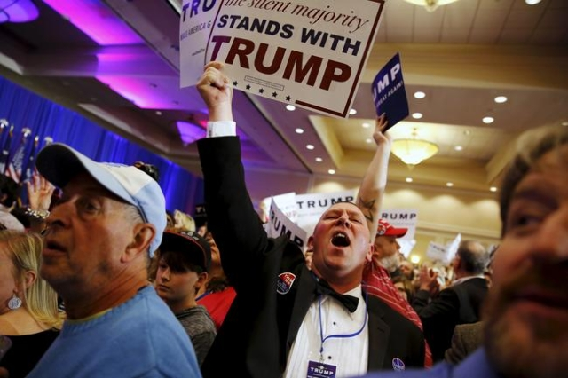 Supporters of Donald Trump celebrate the close of the polls as they watch election results at a rally in Spartanburg, S.C., on Feb. 20, 2016. (REUTERS/Jonathan Ernst)