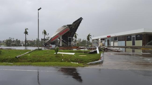 A service station lays in ruin after Cyclone Winston swept through the town of Ba on Fiji's Viti Levu Island, February 21, 2016. REUTERS/Jay Dayal