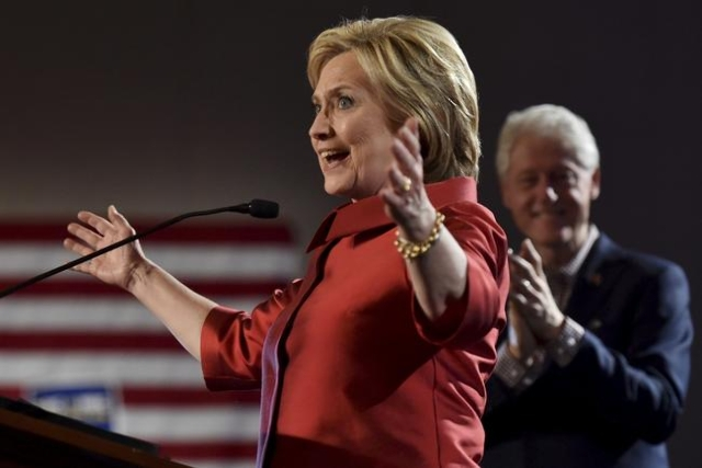 Hillary Clinton speaks to supporters as her husband, former President Bill Clinton, applauds after she was projected to be the winner in the Democratic caucuses in Las Vegas on February 20. (REUTE ...