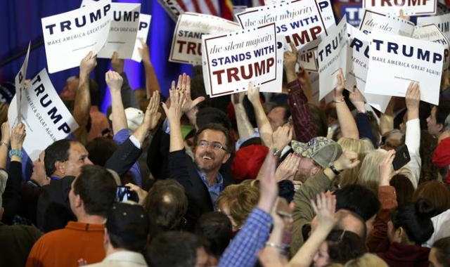 Supporters of Donald Trump celebrate as Trump is projected by television networks as the winner of the South Carolina primary, at his primary night rally in Spartanburg, South Carolina February 20 ...