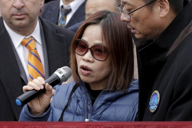 The mother of former NYPD officer Peter Liang, Fenny Liang, speaks at a rally in support of her son in the Brooklyn borough of New York February 20, 2016.  REUTERS/Brendan McDermid