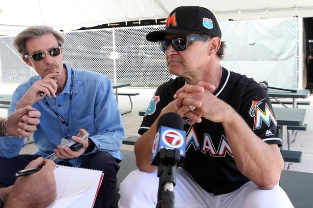 a review of an autobiography of don mattingly Don mattingly shakes hands with miami marlins baseball team president david samson, right, after mattingly was introduced as the new.
