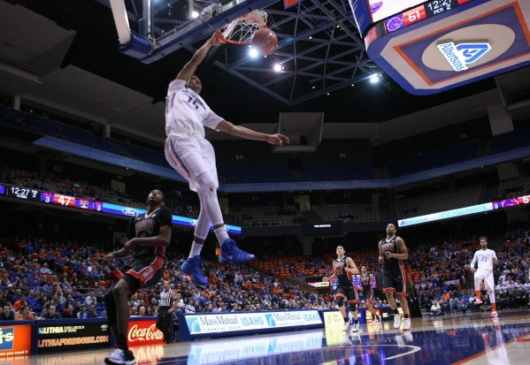 Feb 23, 2016; Boise, ID, USA; Boise State Broncos guard Chandler Hutchison (15) dunks off a fast break during second half action  versus UNLV Rebels at Taco Bell Arena. Boise State defeats UNLV 81 ...