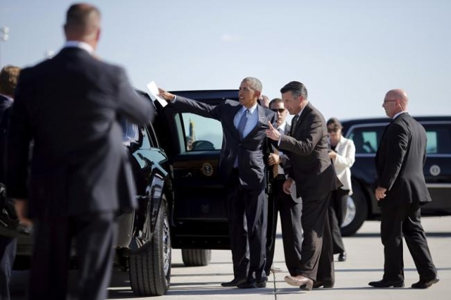 President Obama talks to Nevada Governor Brian Sandoval as he arrives at McCarran International Airport in Las Vegas, August 24, 2015. (Carlos Barria/Reuters)