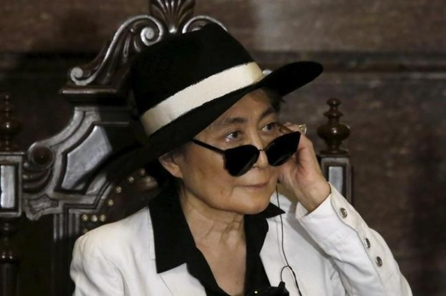 File photo of artist Yoko Ono as she listens through an earpiece before she was honored as 'Illustrious Visitor' by Mexico City's mayor Miguel Angel Mancera at Mexico City' ...