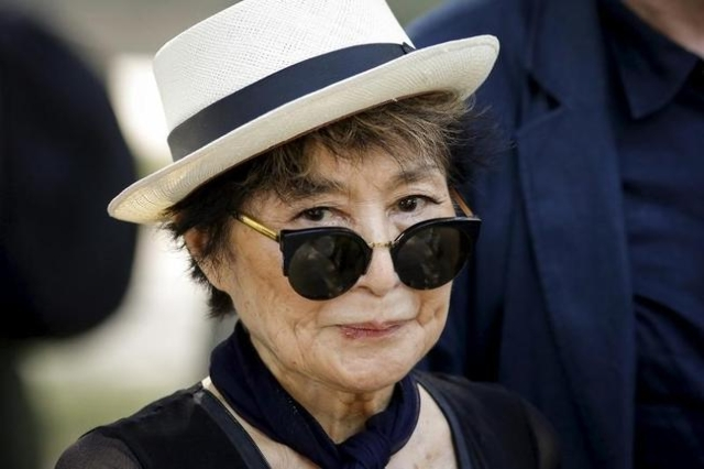 File photo of artist Yoko Ono, widow of John Lennon, as she attends the unveiling of a tapestry honoring Lennon at Ellis Island in New York July 29, 2015. REUTERS/Eduardo Munoz