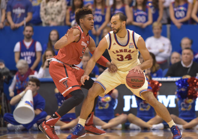Kansas Jayhawks forward Perry Ellis (34) dribbles the ball as Texas Tech Red Raiders forward Justin Gray (5) defends during the first half at Allen Fieldhouse. The Jayhawks won 67-58, winning thei ...