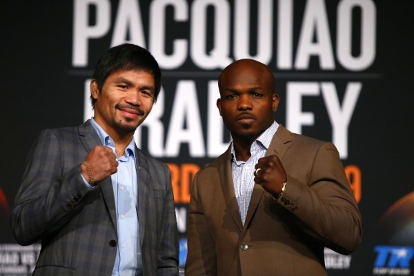 Jan 21, 2016; New York, NY, USA; Manny Pacquiao and Timothy Bradley, Jr. pose for a photo during press conference at Madison Square Garden to announce the upcoming boxing fight on April 9, 2016 in ...