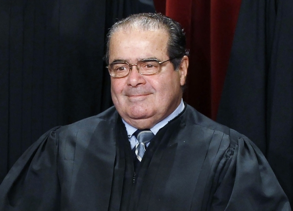 U.S. Supreme Court Justice Antonin Scalia is seen during a group portrait in the East Conference Room at the Supreme Court Building in Washington, in this file photo taken October 8, 2010. Scalia, ...