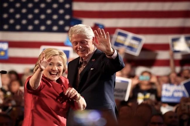 Hillary and Bill Clinton waving (Jeff Scheid/ Las Vegas Review Journal)
