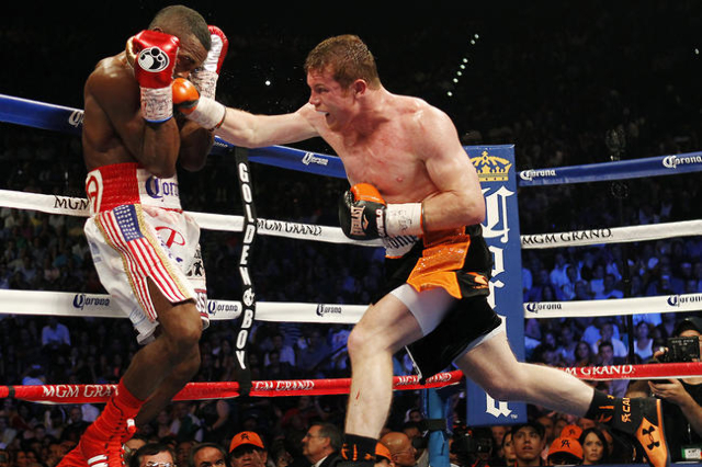 Saul Canelo Alvarez, right, hits Erislandy Lara during their Super Welterweight fight at the MGM Grand Garden Arena in Las Vegas on Saturday, July 12, 2014.(Jason Bean/Las Vegas Review-Journal)
