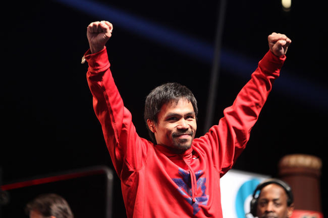 Manny Pacquiao poses during his weigh-in at the sold out MGM Grand Garden Arena in Las Vegas Friday, May 1, 2015. (Erik Verduzco/Las Vegas Review-Journal)