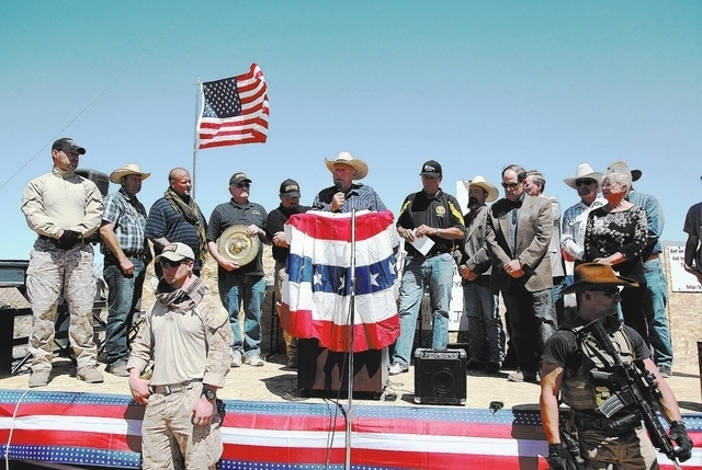 Cliven Bundy addresses a crowd of around 150 during a press conference at the protest camp near his ranch in Bunkerville on Monday, April 14, 2014. (Las Vegas Review-Journal)