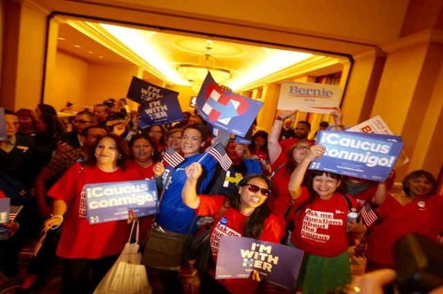 A Hillary Clinton and Bernie Sanders supports rally while standing in line to caucus at Caesars Palace. (Jeff Scheid/Las Vegas Review-Journal)