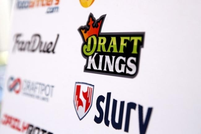 A DraftKings logo is displayed on a board inside of the DFS Players Conference in New York November 13, 2015. (Lucas Jackson/Reuters)
