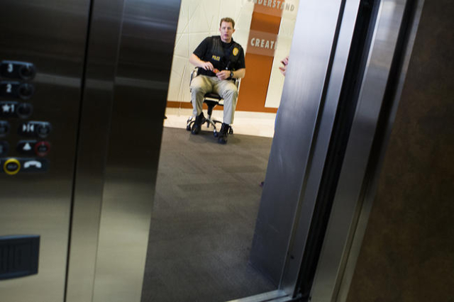 A law enforcement office sits in front of an elevator at LL Bradford and Company  accounting firm on the third floor at 8880 Sunset Road on Thursday, Feb. 18, 2016. (Jeff Scheid/Las Vegas Review-J ...