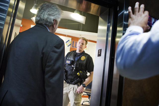A law enforcement officer asks members of the media to leave while standing in front of  LL Bradford and Company  on the third floor  at 8880 Sunset Road on Thursday, Feb. 18, 2016. (Jeff Scheid/L ...
