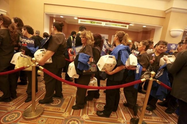 Bellagio hold box lunches while waiting in line to caucus at Caesars Palace. (Jeff Scheid/ Las Vegas Review-Journal)