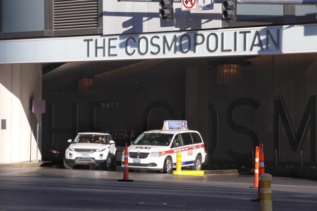 Cars pull out of The Cosmopolitan Las Vegas onto West Harmon on Friday, Feb. 19, 2016, in Las Vegas. An overnight shooting near the Las Vegas Strip left two women dead and a man in critical condit ...
