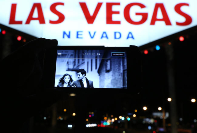 The logo of car-sharing service app Uber is seen on a smartphone at the Welcome to Fabulous Las Vegas sign Wednesday, May 6, 2015. (Bizuayehu Tesfaye/Las Vegas Review-Journal) Follow Bizu Tesfaye  ...