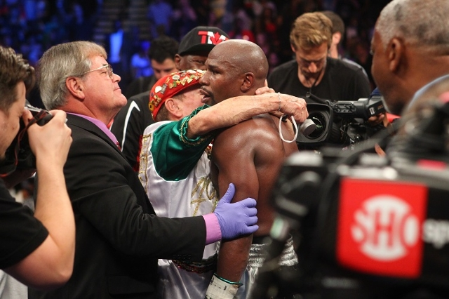 Floyd Mayweather Jr., left, connects with Andre Berto during their welterweight title boxing match at the MGM Grand Garden Arena in Las Vegas on Saturday, Sept. 12, 2015. Mayweather won by unanimo ...