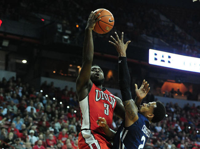 UNLV guard Jordan Cornish (3) goes up for a shot against UNR guard Tyron Criswell in the first half of their NCAA college basketball game against UNLV at the Thomas & Mack Center in Las Vegas  ...
