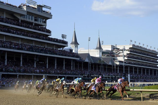 May 2, 2015; Louisville, KY, USA; Martin Garcia aboard Dortmund leads the field into turn one during the 141st Kentucky Derby at Churchill Downs. (Jamie Rhodes/USA Today Sports)