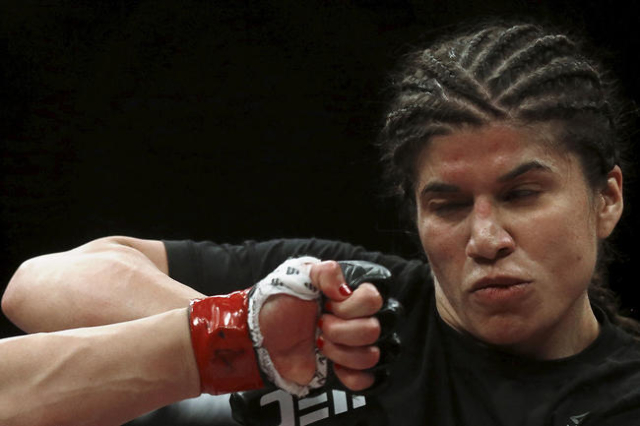 Jessica Aguilar of Mexico tries to skip a punch of Claudia Gadelha of Brazil during their Ultimate Fighting Championship (UFC) match, a professional mixed martial arts (MMA) competition in Rio de  ...