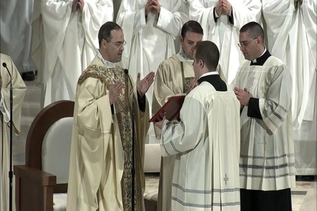 Rev. Paul Scalia, the son of late Supreme Court Justice Antonin Scalia, says a prayer during the funeral Mass for his father at the National Shrine of the Immaculate Conception in Washington on Fe ...