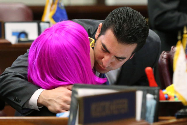 Nevada Sen. Ruben Kihuen, D-Las Vegas, congratulates Sen. Debbie Smith, D-Sparks, following Senate passage of a record $1.1 billion general fund tax package at the Legislative Building in Carson C ...