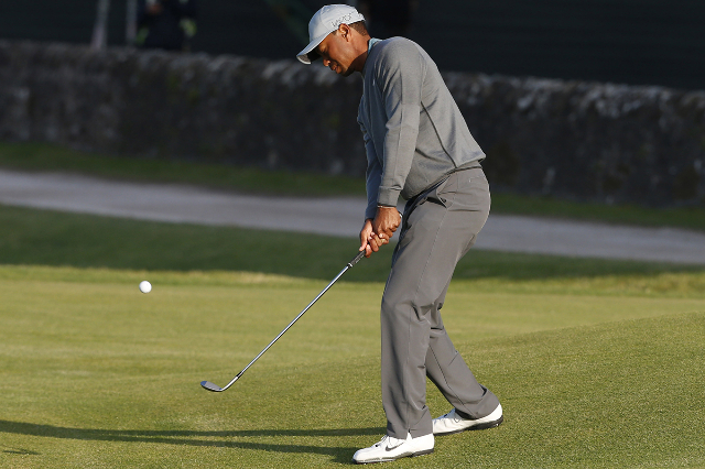 Jul 13, 2015; St. Andrews, Scotland, GBR; Tiger Woods hits a chip shot on the 16th hole during a practice round for the 144th Open Championship at Royal and Ancient Golf Club of St Andrews. (Brian ...