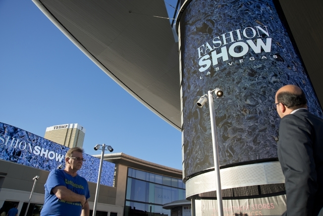 """Visitors walk by one of the massive screens recently added to the pillars underneath the """"Cloud,"""" a steel canopy at the Fashion Show Mall on the Las Vegas Strip on Thursday, Feb. ..."""