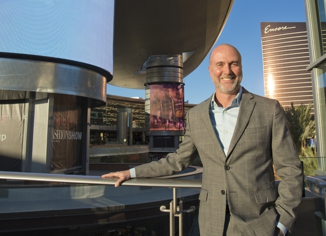 "Fashion Show Mall General Manager Jim Heilmann poses for a portrait in front of the massive screens recently added to the pillars underneath the ""Cloud,"" a steel canopy at the Fa ..."