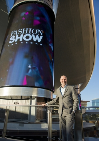 Fashion Show Mall General Manager Jim Heilmann poses for a photograph near one of the massive screens recently added to the pillars underneath the steel canopy in front of the mall on the Las Vega ...